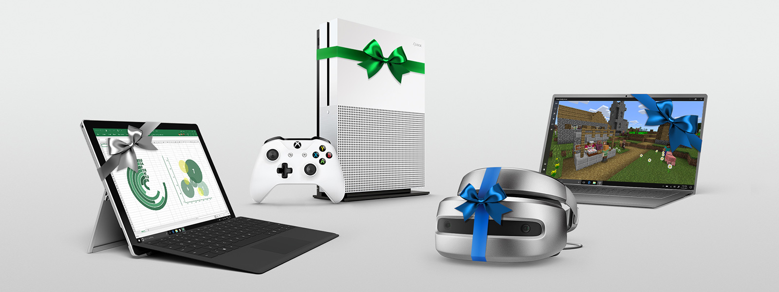 A Windows Mixed Reality Headset, a Windows 10 PC, a Surface Pro and an Xbox One S all with ribbons on them.