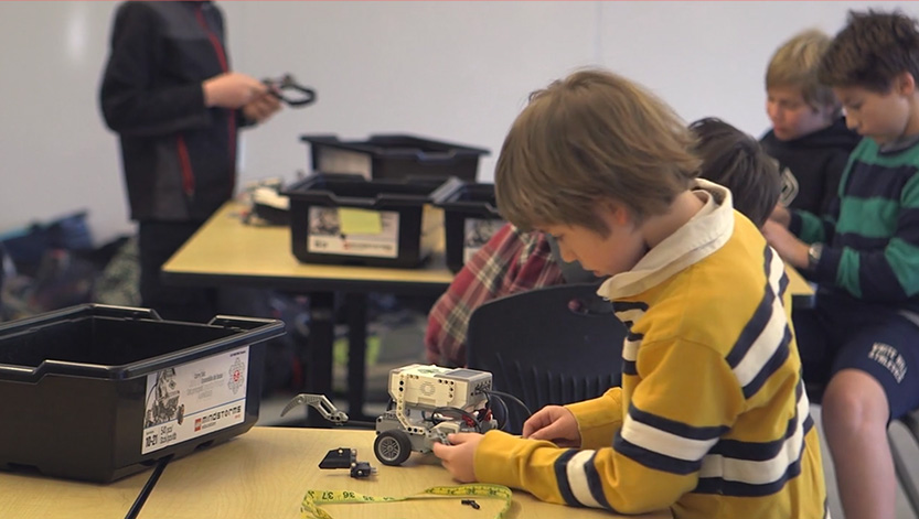 Play Video, Boy making a robotic vehicle.