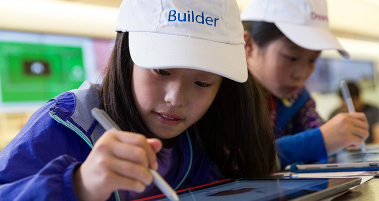 Child using surface pro at in-store Microsoft event