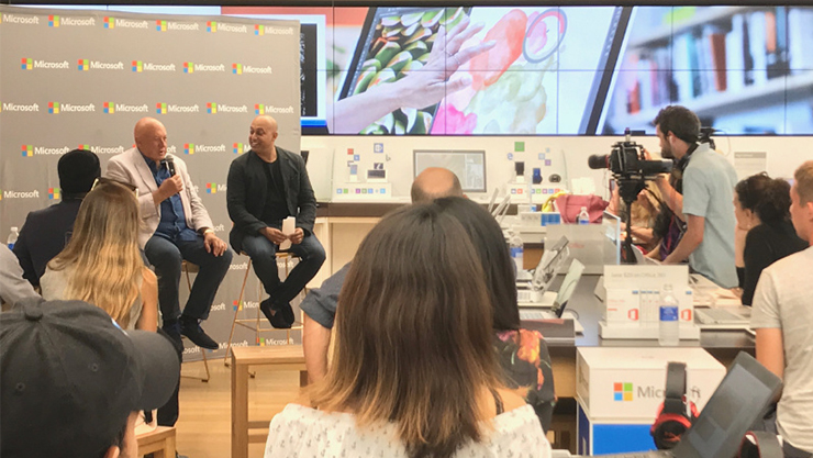 Group of people at a Microsoft Store presentation.