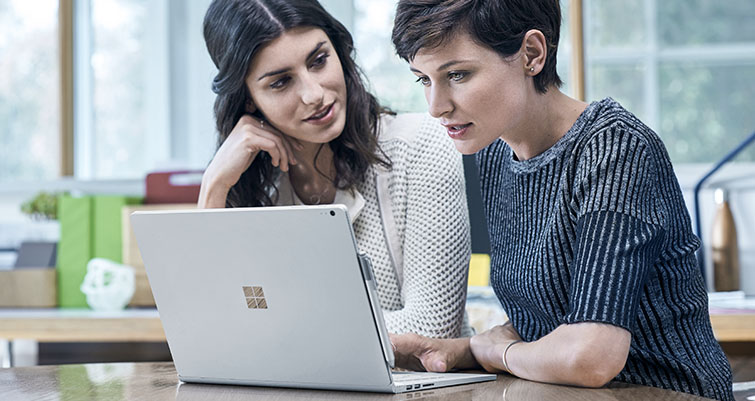 Business women working on surface