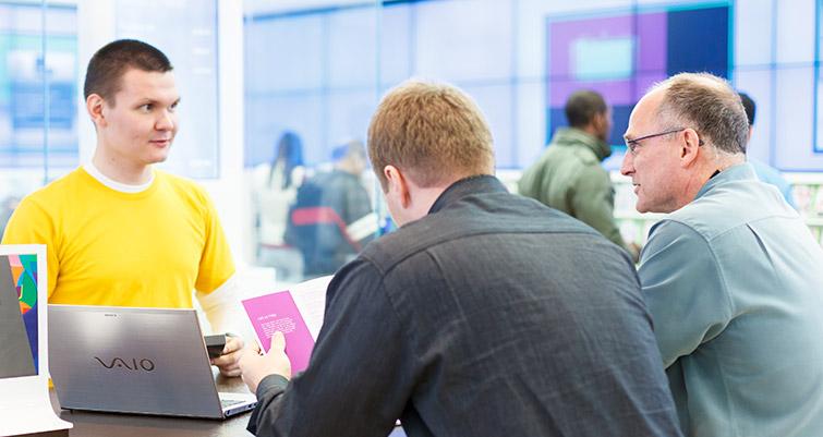 Answer Desk associate helping customers