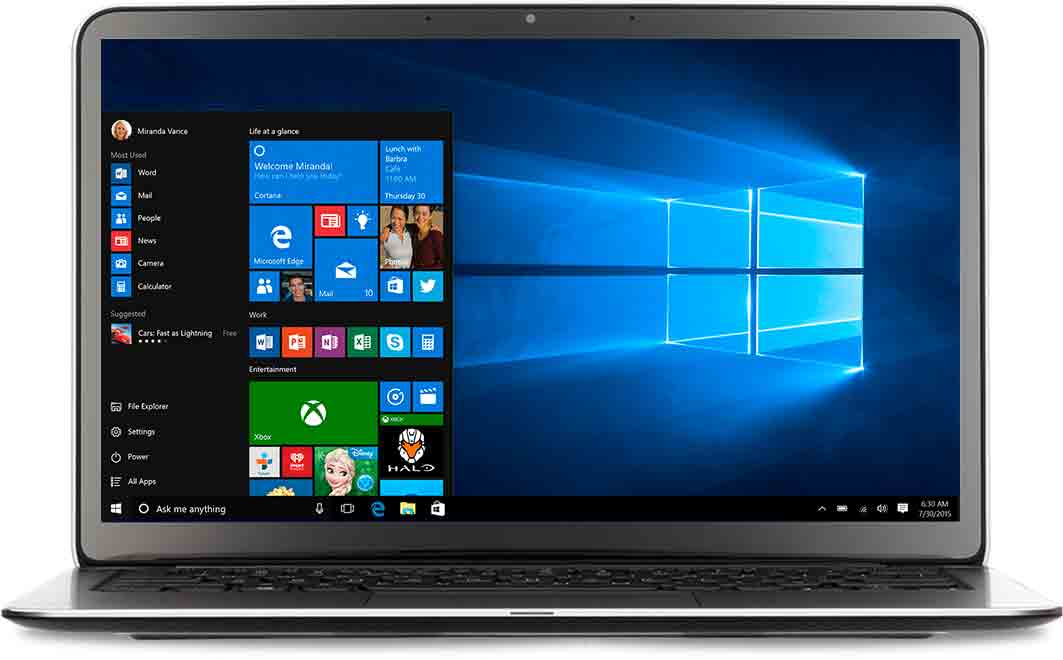 A laptop facing forwards with Windows 10 start menu open on screen