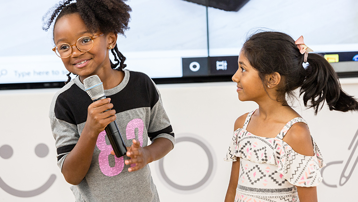 Students speaking at Microsoft Store event.