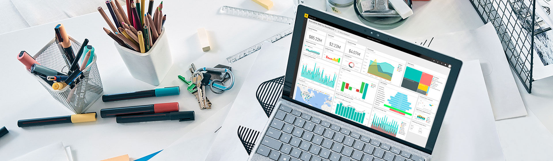 Empty desk with desktop monitor showing Power BI