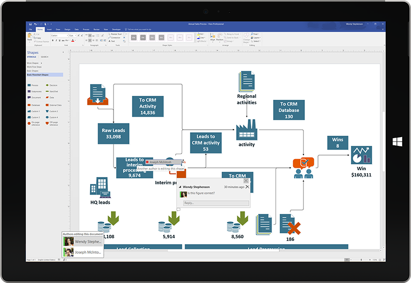 A Surface tablet showing collaboration on a Visio diagram, with comments from other users appearing on the screen