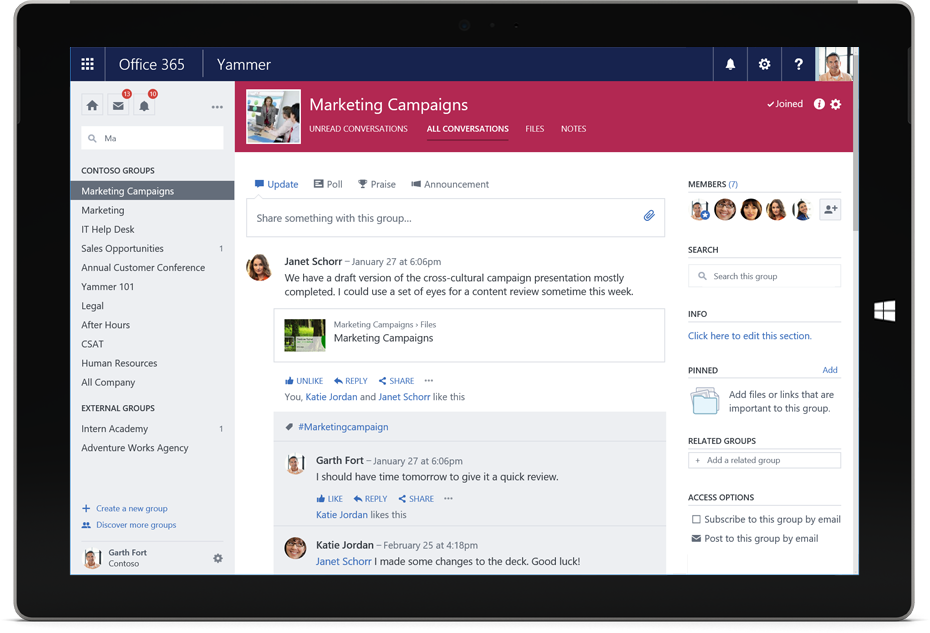A Surface tablet displays a Yammer conversation