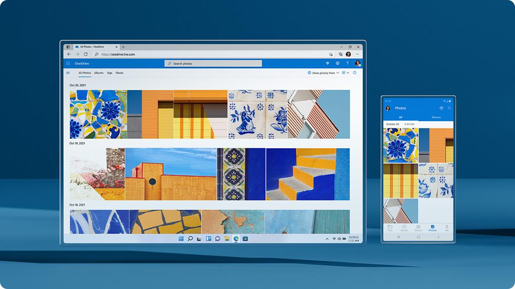 Pantalla de Windows 11 y celular que muestra la ventana de copia de seguridad de OneDrive