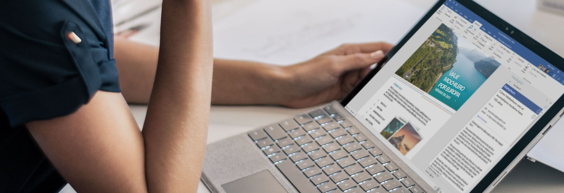 Tableta Microsoft Surface en la que se muestra un documento de Word sobre un viaje mochilero por Europa con el Investigador de Word abierto.