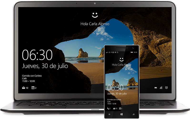 """Un portátil y un teléfono con la pantalla Inicio de Windows10. Hay una carita sonriente encima de cada uno sobre la frase """"Hola Miranda Vance"""""""