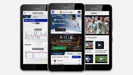 Real Madrid app being shown on screens of three different smartphones