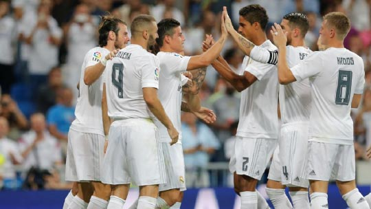 Real Madrid team congratulating each other on the field