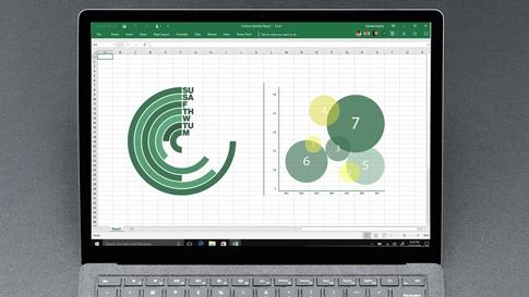Lintuperspektiivikuva platinanvärisestä Surface Laptopista, jonka näytössä on Excel.