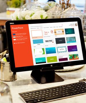 स्लाइड डिज़ाइंस की PowerPoint गैलरी दिखा रहा एक PC मॉनीटर.