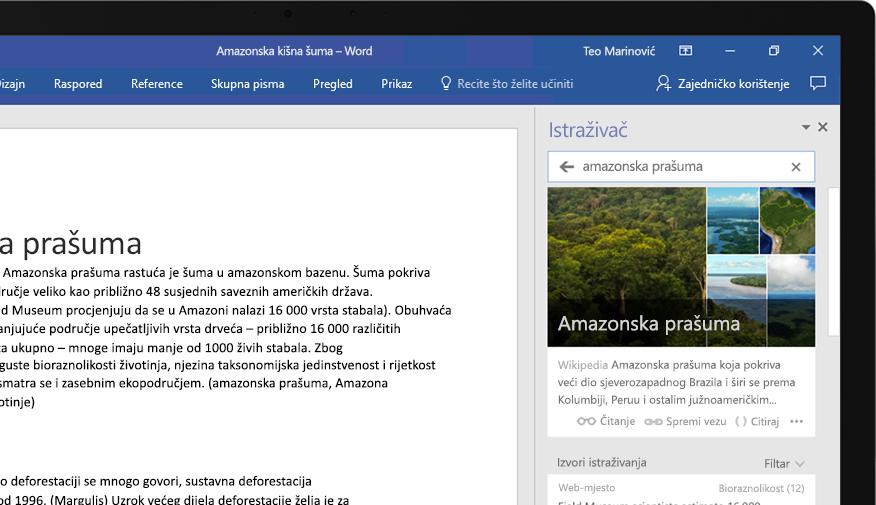 Prijenosno računalo s prikazanim dokumentom programa Word i uvećanim prikazom značajke Istraživač s člankom o amazonskoj kišnoj šumi
