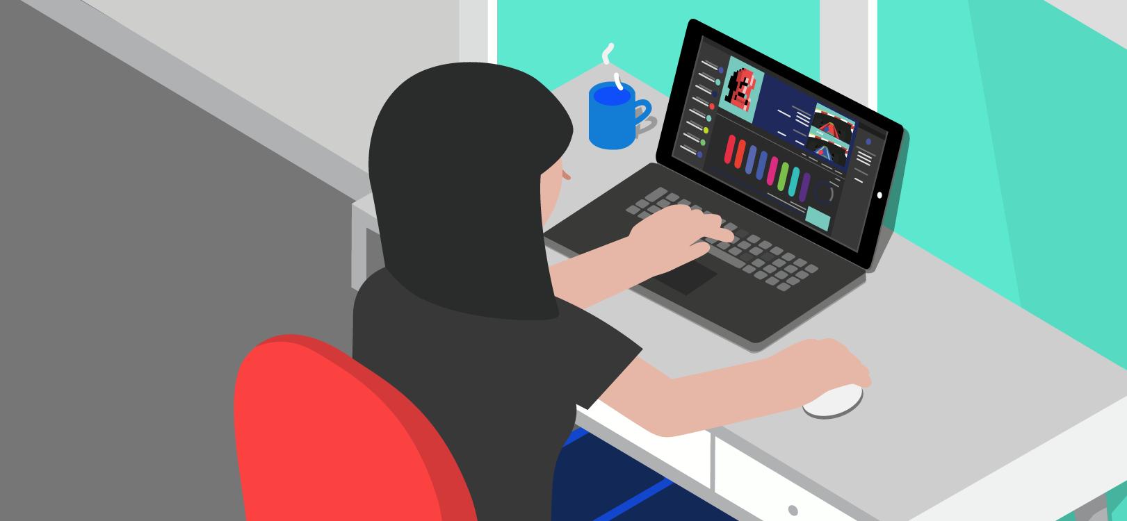 Laptopot használó nő az asztalnál