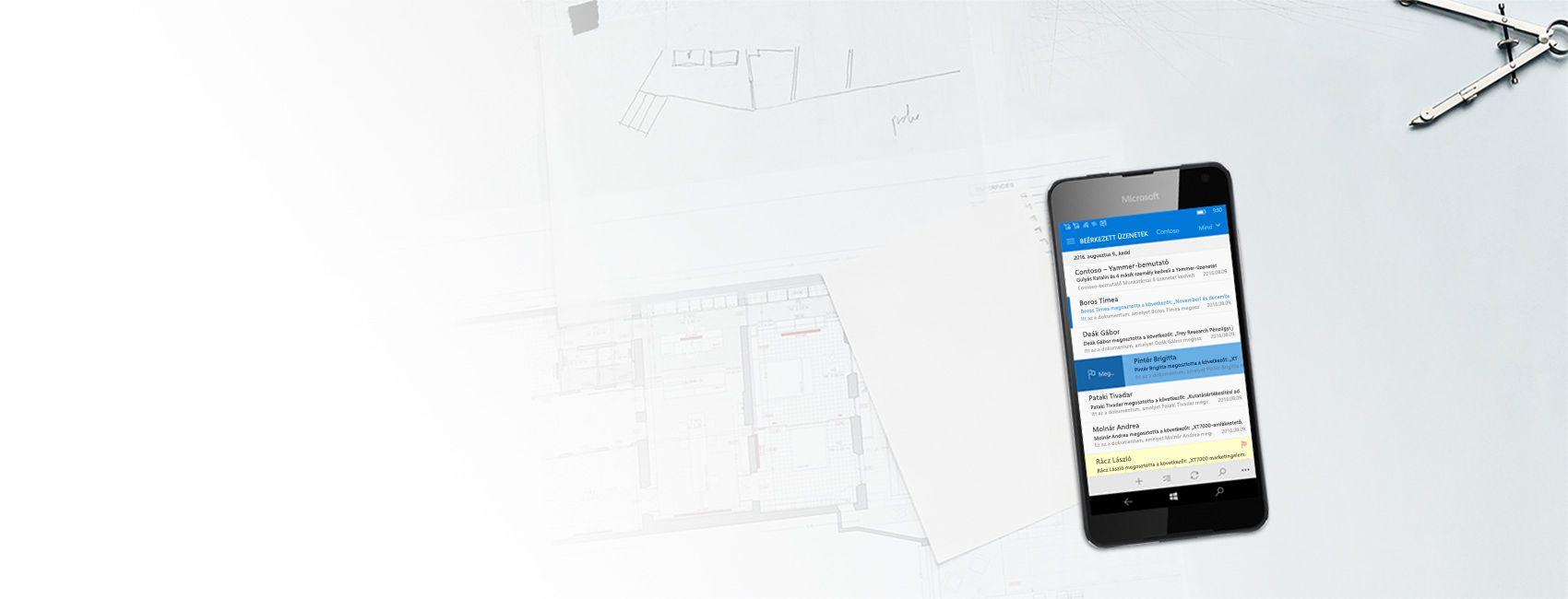 Windows-telefon, melynek a képernyőjén egy e-mail-postaláda tartalma látható a Windows 10 Mobile-hoz készült Outlook appban