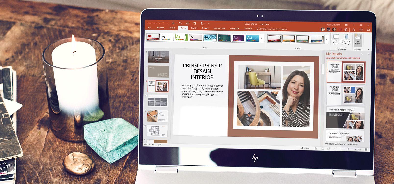 Layar laptop menampilkan dokumen PowerPoint menggunakan fitur PowerPoint Designer