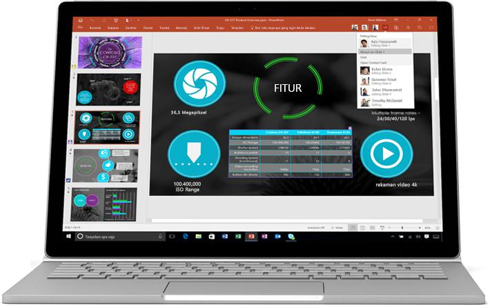 Laptop menampilkan slide presentasi PowerPoint yang sedang dikerjakan tim dalam kolaborasi.