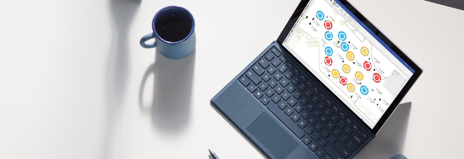 Laptop menampilkan diagram alur kerja proses di Visio