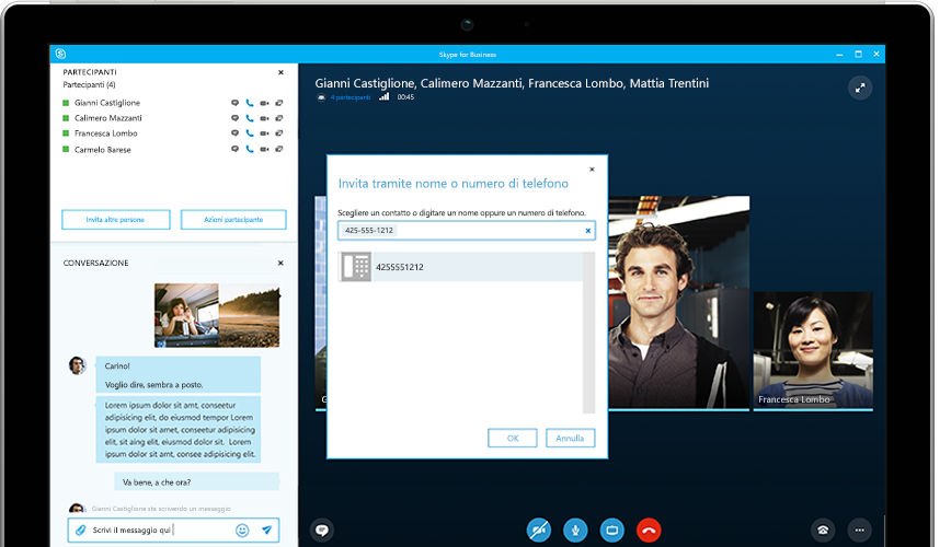 Persona che digita su un tablet Surface, con una riunione online di Skype for Business che compare sullo schermo