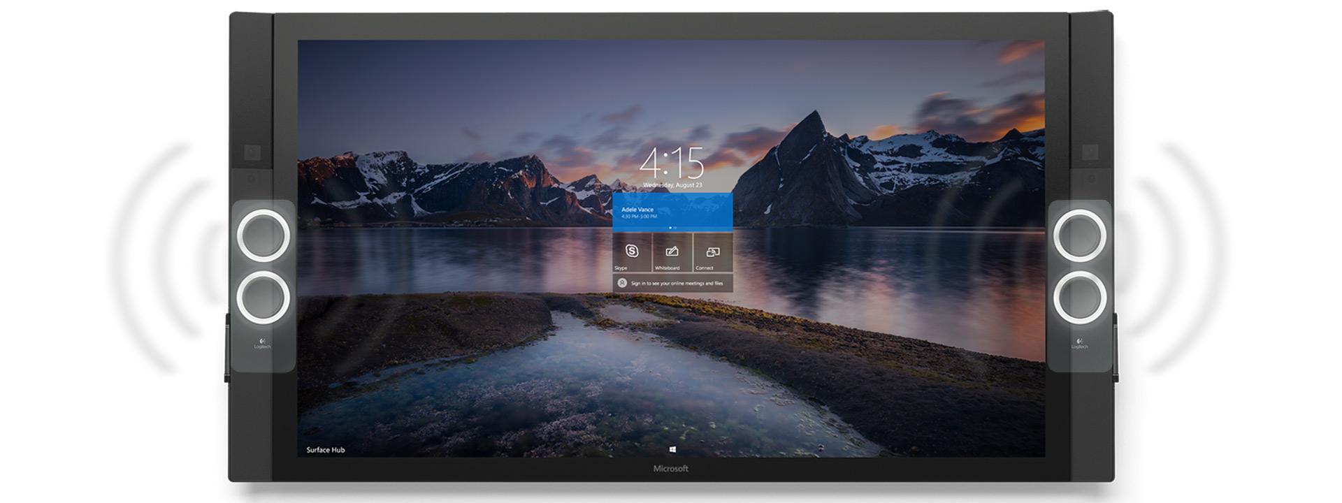 スピーカーが音で振動するイラストが示された、自然の風景のスタート画面が表示された Surface Hub の正面図。