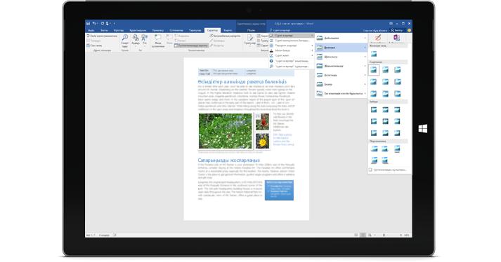 Word құжатында жаңа «Маған айту» мүмкіндігі көрсетілген Surface планшеті.