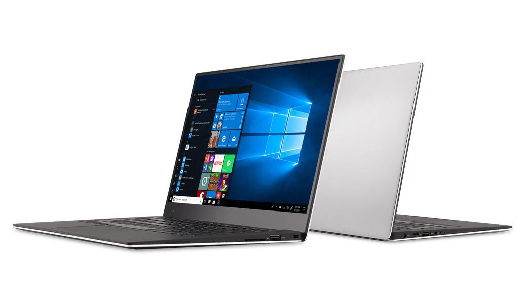 """Du """"Windows 10"""" nešiojamieji kompiuteriai, atremti vienas į kitą"""