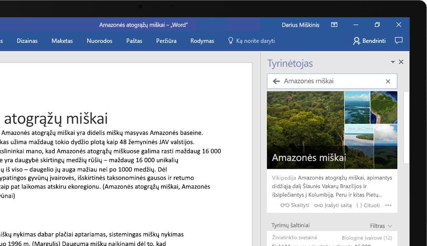 """Nešiojamasis kompiuteris, kuriame matomas """"Word"""" dokumentas su padidinta tyrinėtojo funkcija ir straipsniu apie Amazonės miškus"""