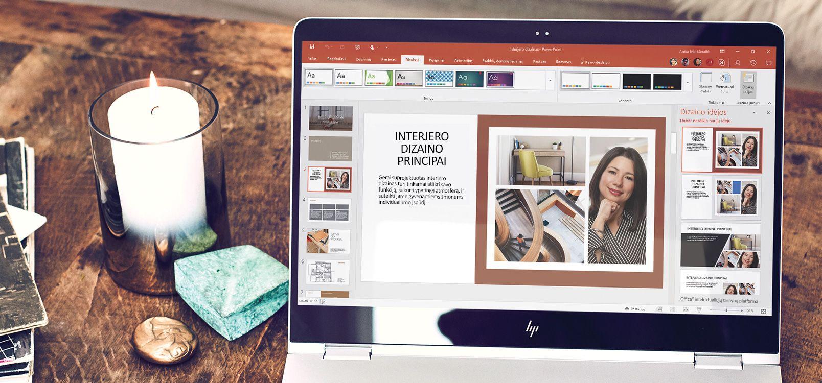 """Nešiojamojo kompiuterio ekranas, kuriame rodomas """"PowerPoint"""" dokumentas su """"PowerPoint"""" dizaino įrankiu"""