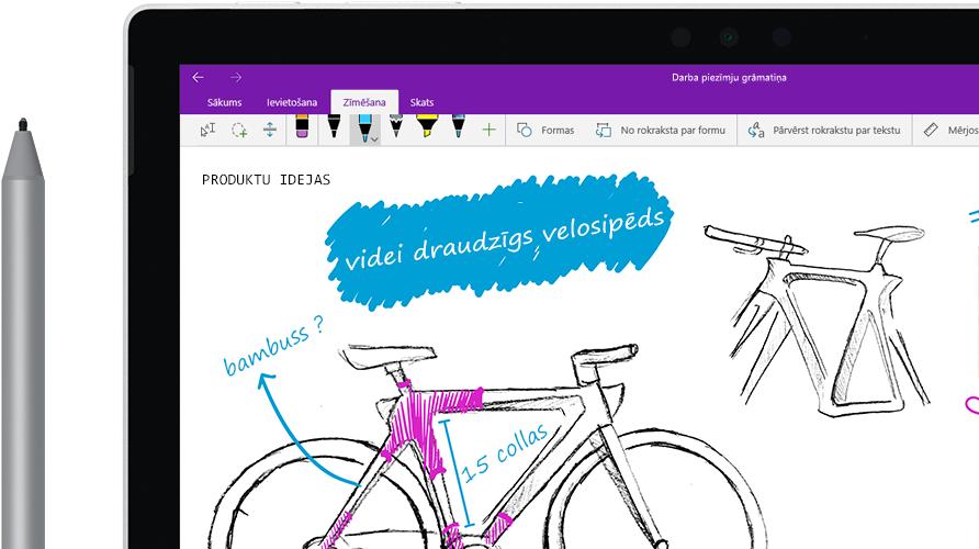 """Planšetdatorā redzams ar ciparpildspalvu zīmēts attēls, kuru sauc """"Videi draudzīgs velosipēds""""."""