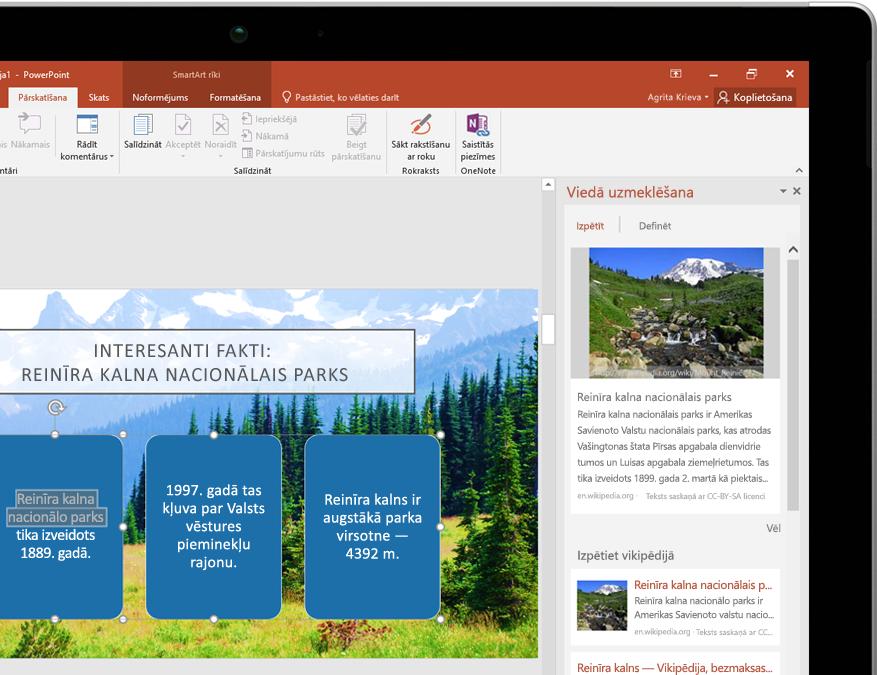 Planšetdators, kurā redzama viedā uzmeklēšana programmā PowerPoint