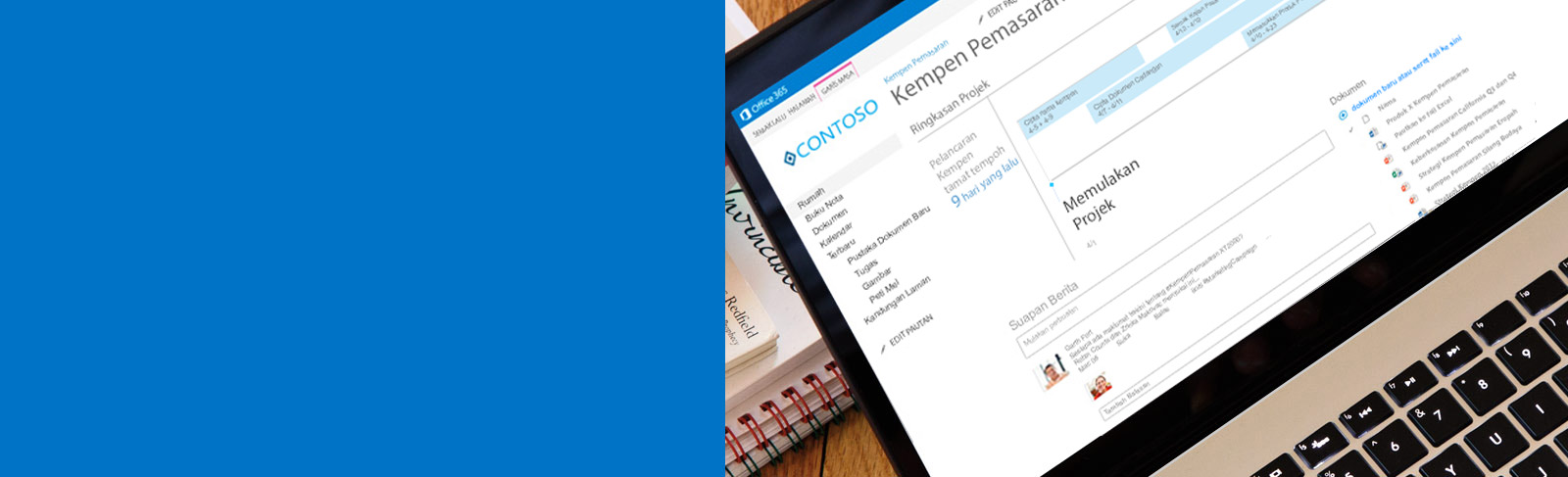Komputer riba menunjukkan dokumen sedang dicapai pada SharePoint.
