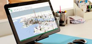 En skjerm på en bærbar datamaskin viser Power B.I. for Office 365. Lær mer om Microsoft Power B.I.