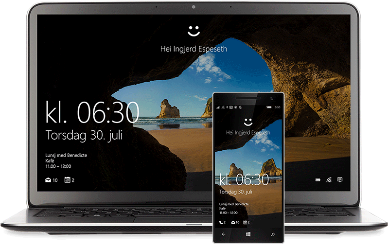 """En bærbar datamaskin og en telefon med startskjermen på Windows10. Det er et smilefjes på begge skjermene over ordene """"Hello Miranda Vance"""""""