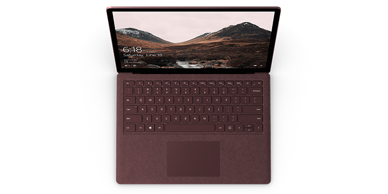 Surface Laptop i burgunder sett ovenfra