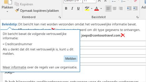 Close-up van een e-mailbericht met een beleidstip om te voorkomen dat gevoelige informatie wordt verzonden.
