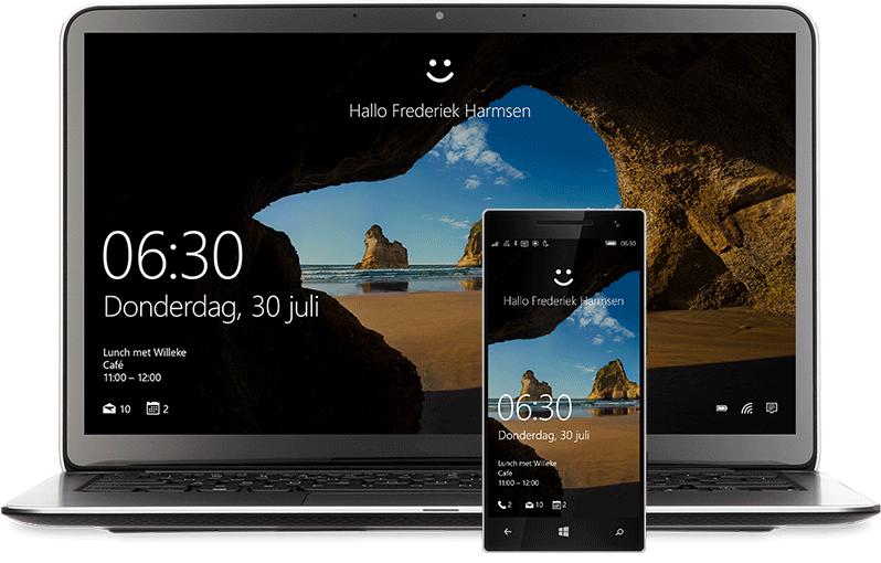 Een laptop en een telefoon met daarop het Windows 10 Startscherm. Bovenaan een lachebekje en de woorden 'Hallo Miranda Vance'