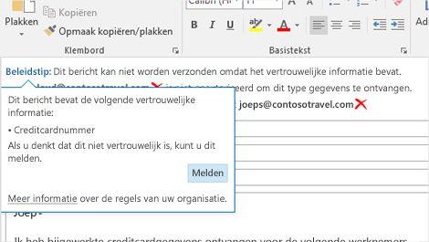 Close-up van een beleidstip in een e-mail om te voorkomen dat gevoelige informatie wordt verzonden.