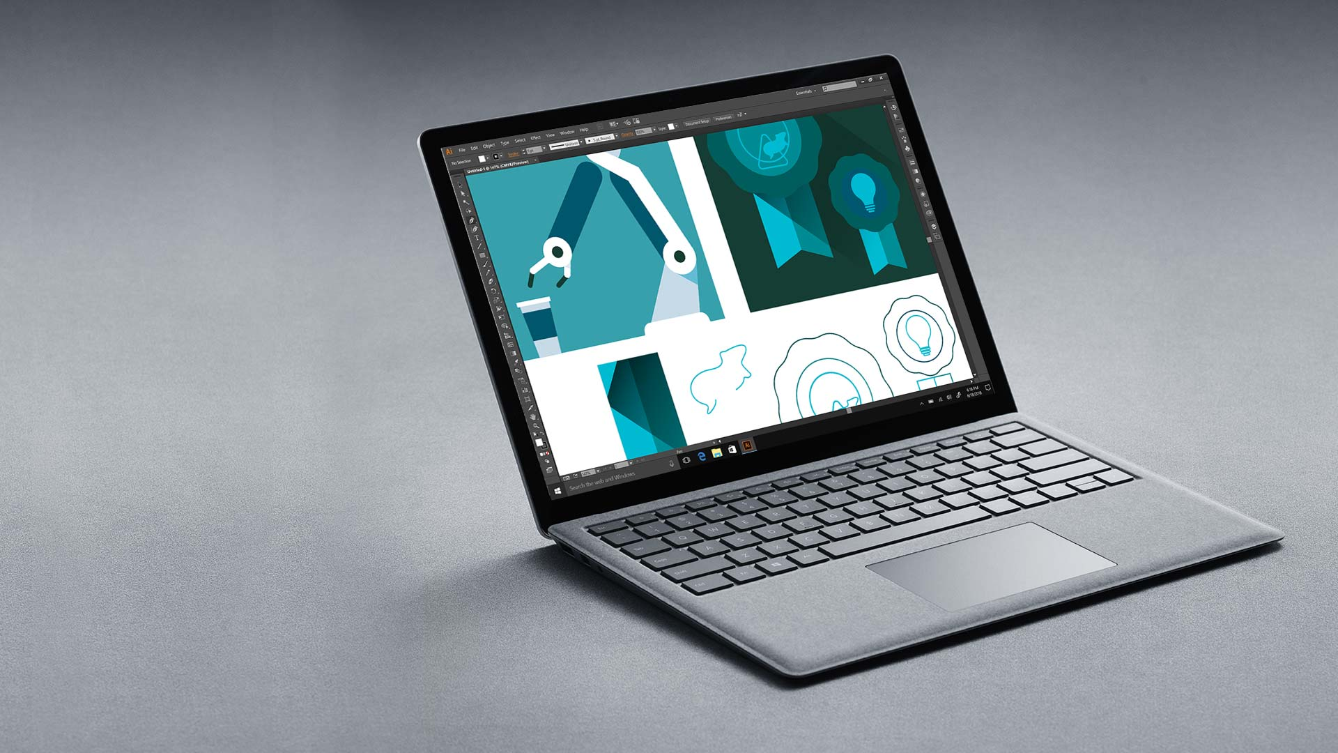 Platina (zilverkleurige) Surface Laptop met Adobe Illustrator-scherm.