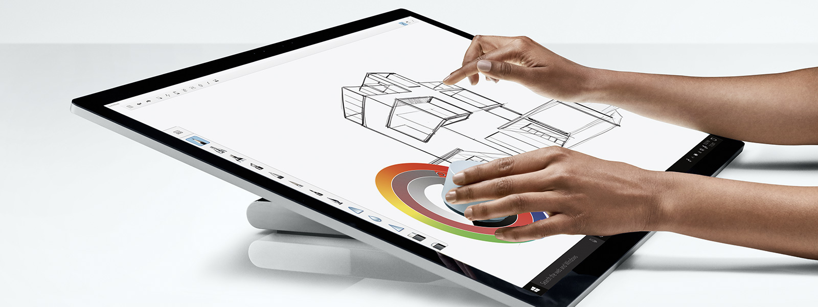Persoon die aan de slag is met de Surface Studio met de Surface Dial