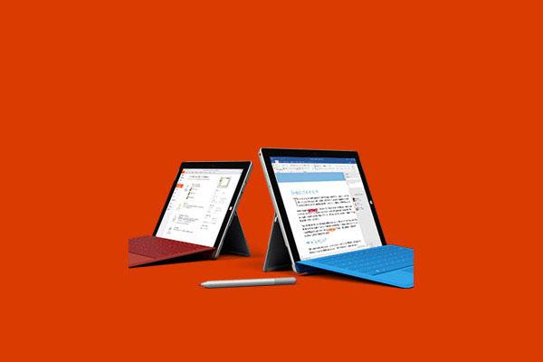 Een blauwe en rode tablet met toetsenborden