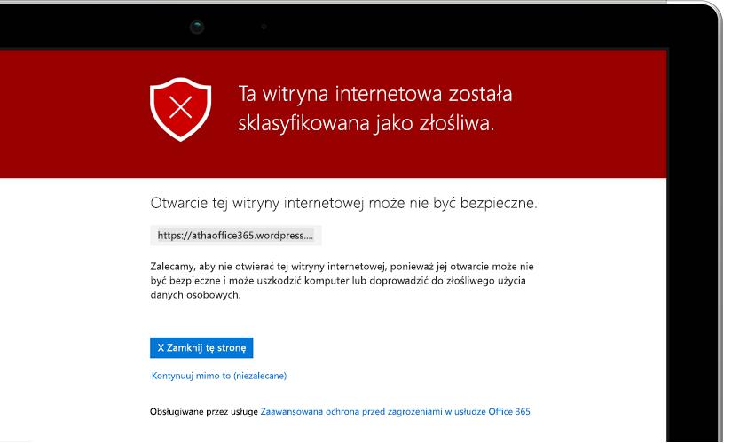 Zdjęcie przedstawiające zbliżenie na ekran laptopa z wyświetlonym komunikatem ostrzegawczym