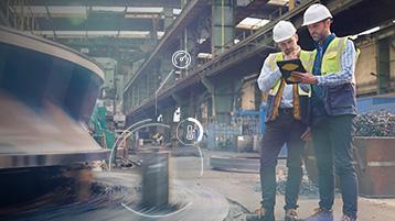 Pracownicy branży produkcyjnej korzystający z nowoczesnej technologii