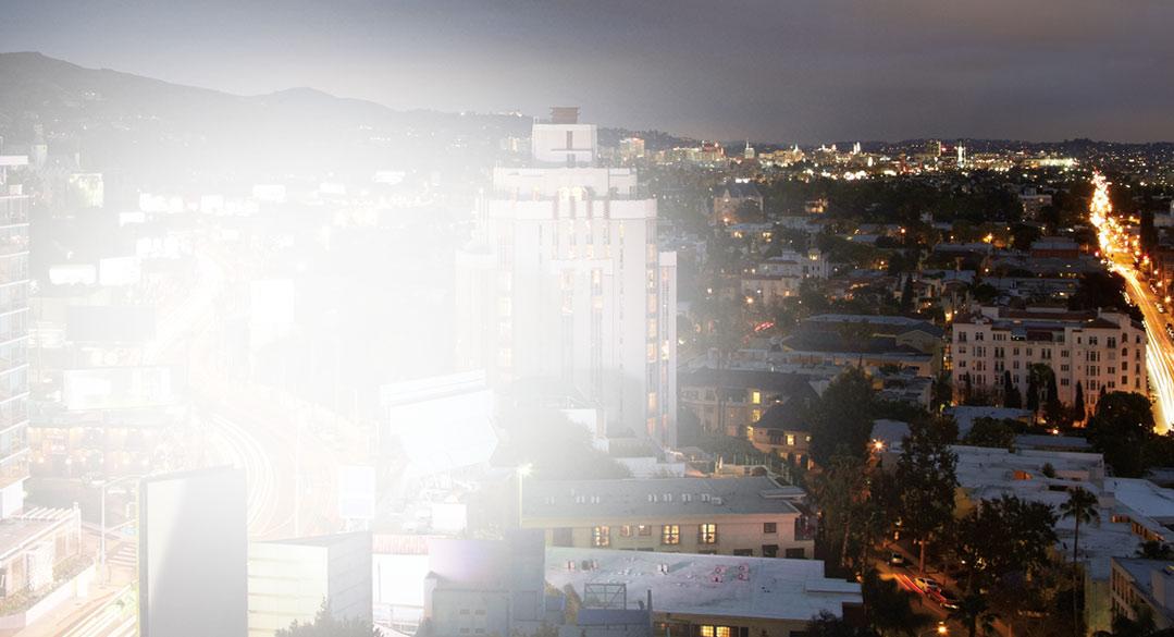 Visão noturna de uma cidade grande. Leia histórias de clientes do Exchange de todo o mundo.