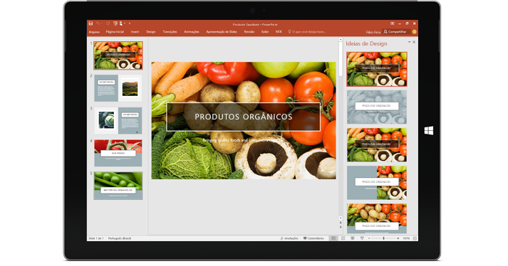 Um tablet mostrando o recurso Designer em um slide de apresentação do PowerPoint.