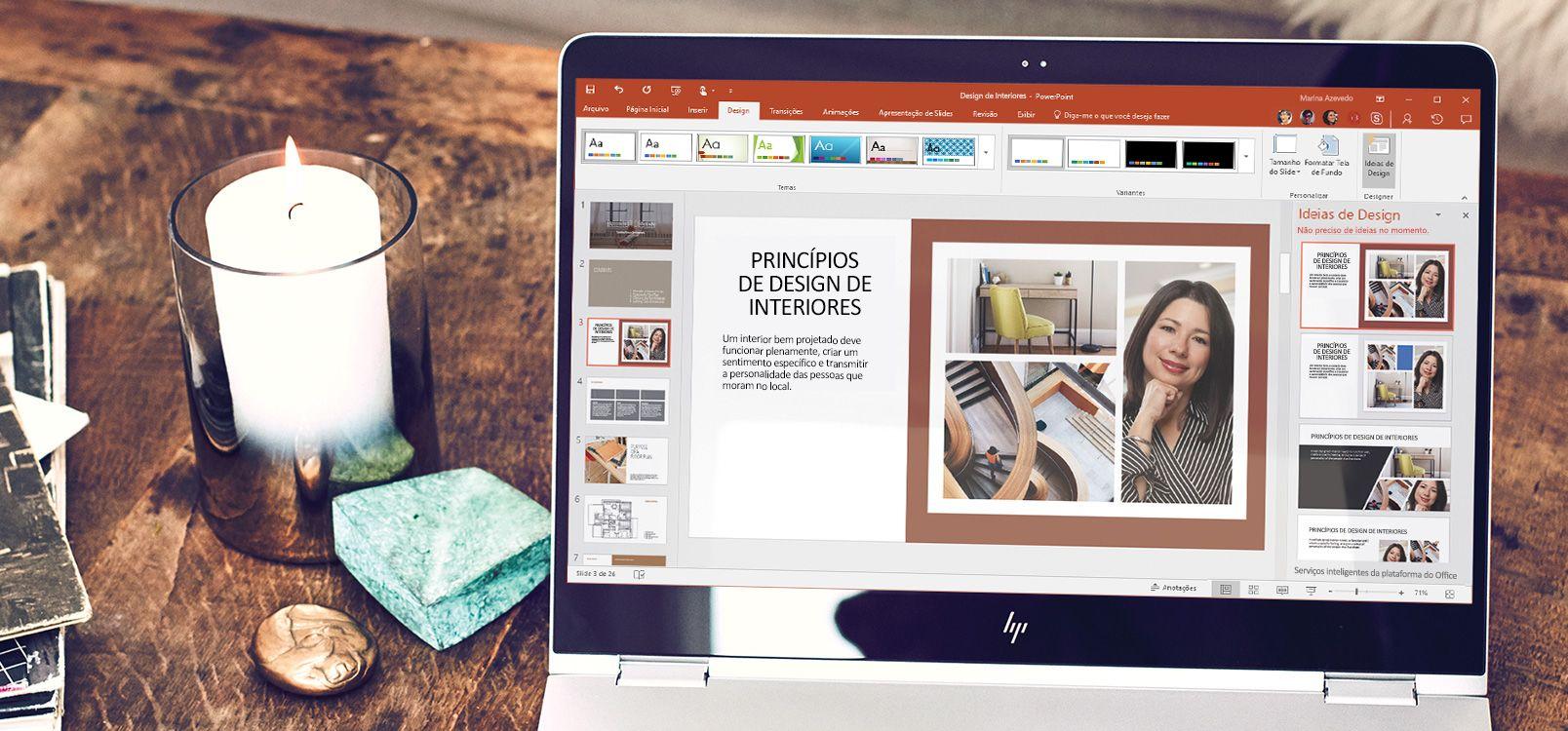 Tela de um laptop mostrando um documento do PowerPoint usando o recurso Designer do PowerPoint
