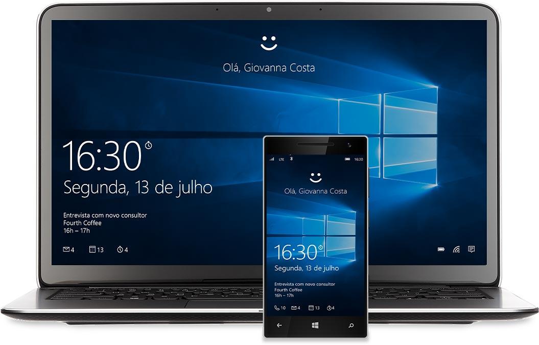 """Um notebook e um telefone com a tela inicial do Windows 10 exibida. Há um smiley sobre todas as palavras acima: """"Olá, Miranda Vance"""""""