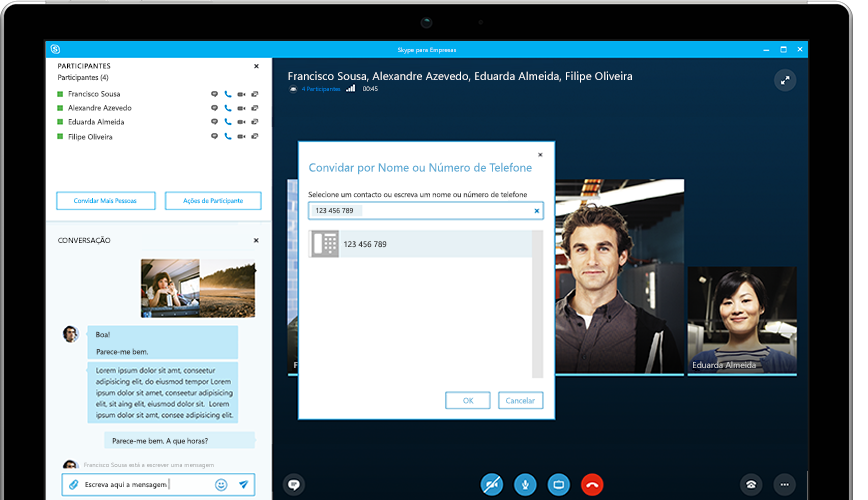 Uma pessoa a escrever num tablet Surface, com uma reunião online do Skype para Empresas a aparecer no ecrã