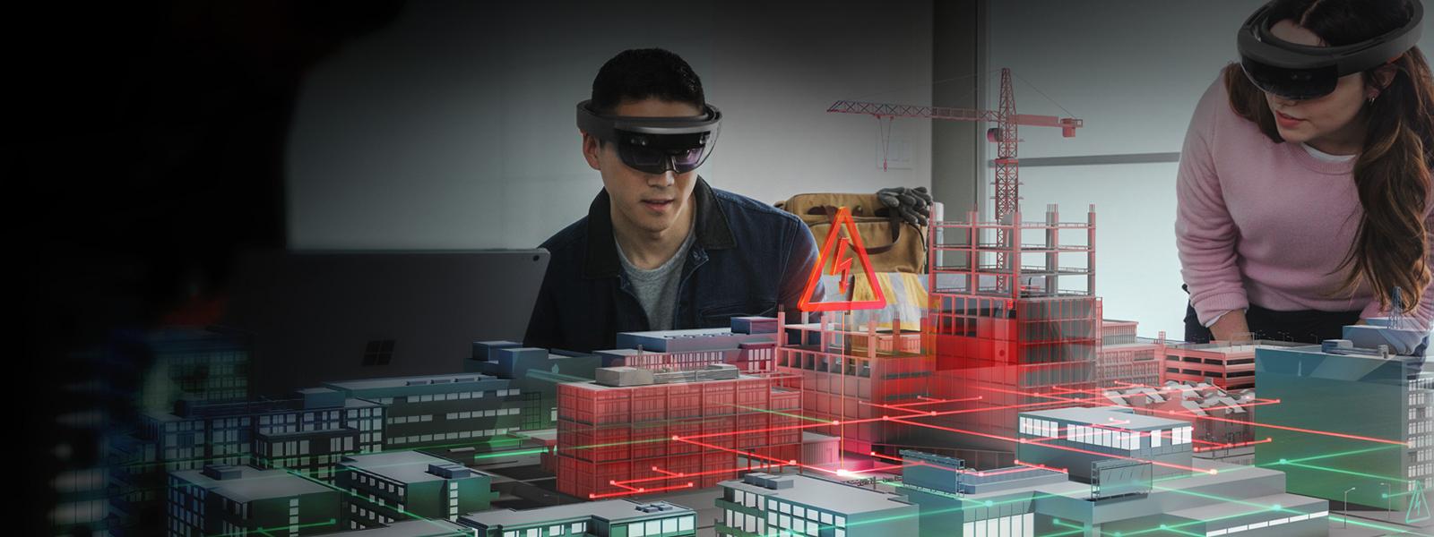 Un bărbat și o femeie cu un HoloLens se uită la un model virtual de construcție